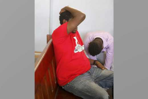 Pictures: Emmy Kosgei's brother hides face as he appears before court for killing man
