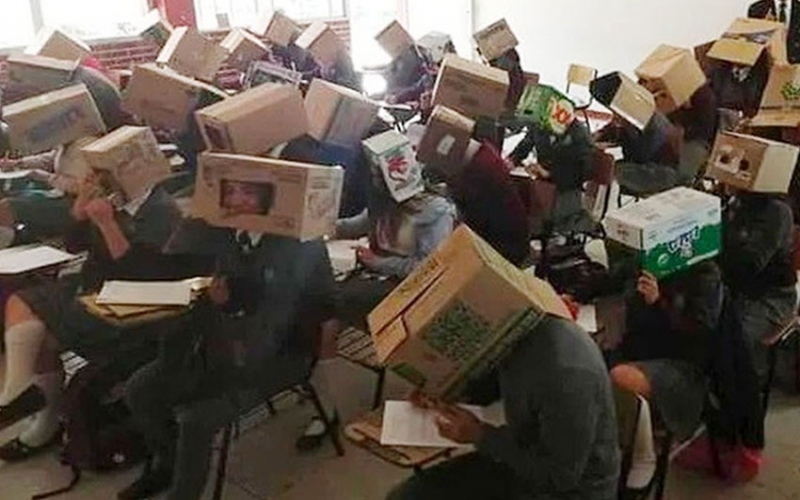 Teacher forces students to wear cardboard boxes to curb cheating