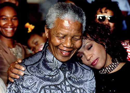 The late singer Whitney Houston shared a hug with Nelson Mandela (Photo:TVNZ