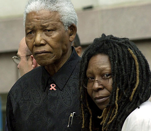 Nelson Mandela stands with Whoopi Goldberg in New York (Photo: Rex)