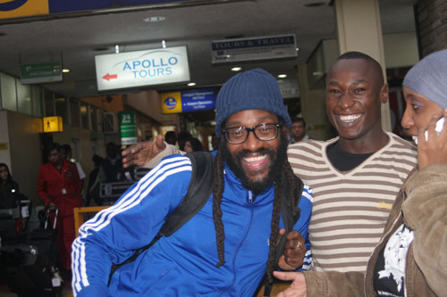 Photo: Courtesy   Tarrus Riley poses with a fan at JKIA