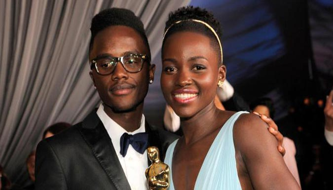 Lupita and her brother, Juniour (Photo: John Shearer: AP)