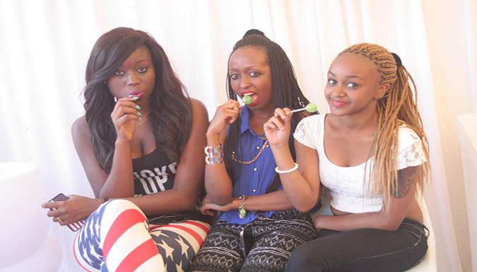 Female rugby fans pose for a photo at the Masaku 7