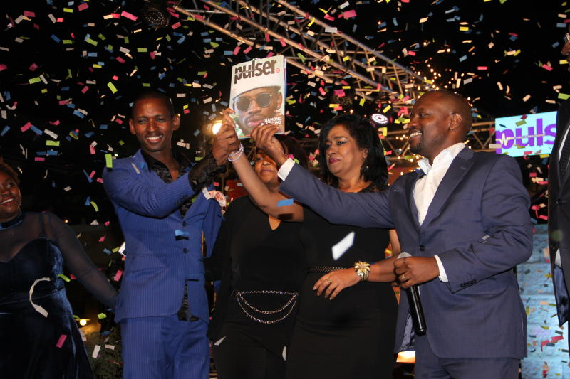 From left)Pulse Editor Stevens Mwendo,Nairobi Women Representative Esther Pasaris(C)Standard media group CEO Olando Lyomu(Right)display Pulser magazine which was launch at Junction mall in Nairobi on