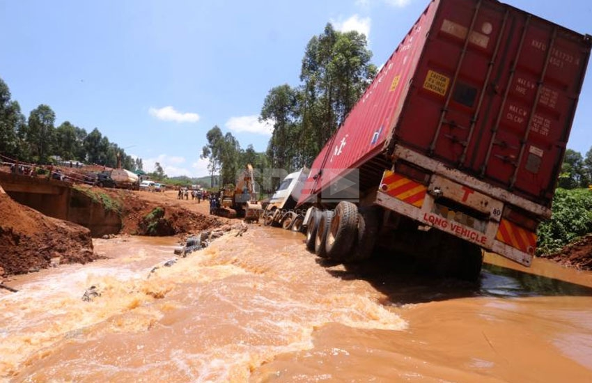 Narrow escape for motorists after floods sweep away vehicles