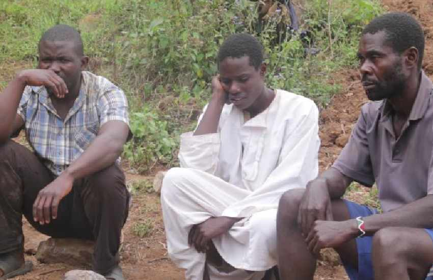 Three forced to camp at river till friend's body is found