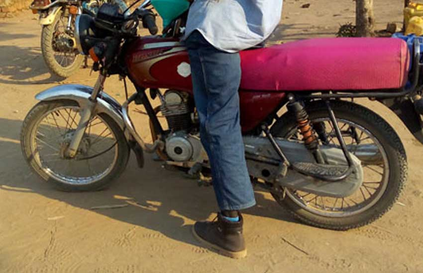 Hard times? Former State Minister moving around in a 'boda boda'