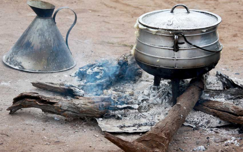 Man nabbed by mob after killing wife as she prepared food
