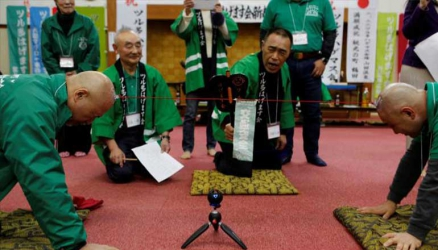 My head still hurts: Japanese men hold competition to celebrate baldness