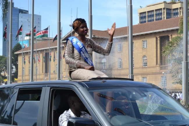 Nakuru contestant arrives in a sleek car, armed with a smile waving to people at the venue