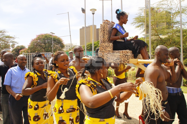 Kitui beauty arrived as royalty, being carried on her 'throne' as dancers escorting her through