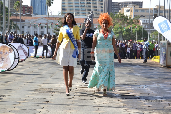Miss Tourism Nyeri contestant does her cat walk as she arrives at the venue