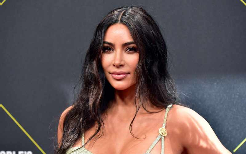 Kim Kardashian 'at war' with Jennifer Aniston after she urges fans 'don't vote' for Kanye