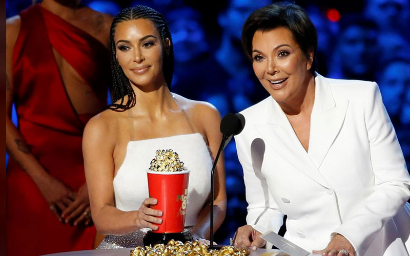 Reality Stars Kim Kardashian (L) and Kris Jenner a