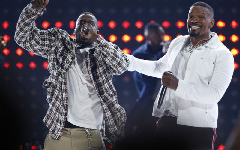 BET host Jamie Foxx performs with Jay Rock to open