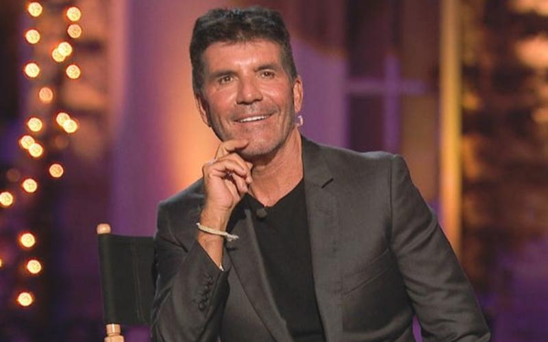 Simon Cowell takes 'a few steps' after breaking his back