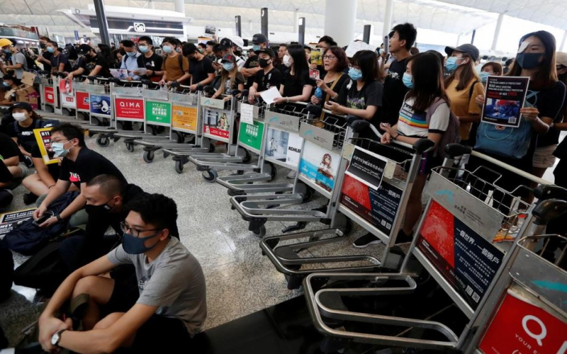 Hong Kong airport suspends check-in as leader bemoans 'panic and chaos'