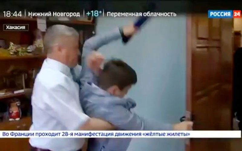 VIDEO: Pro-Vladimir Putin official tackles journalist asking about alleged corruption