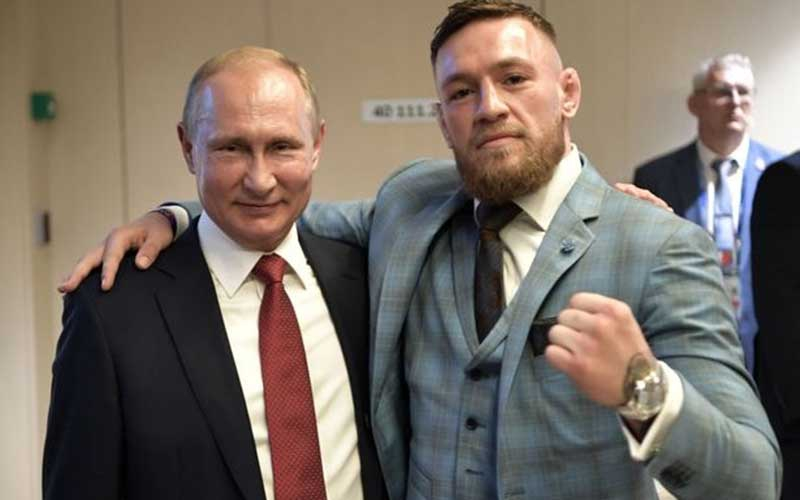 Vladimir Putin tests Conor McGregor's whisky for poison before drinking it