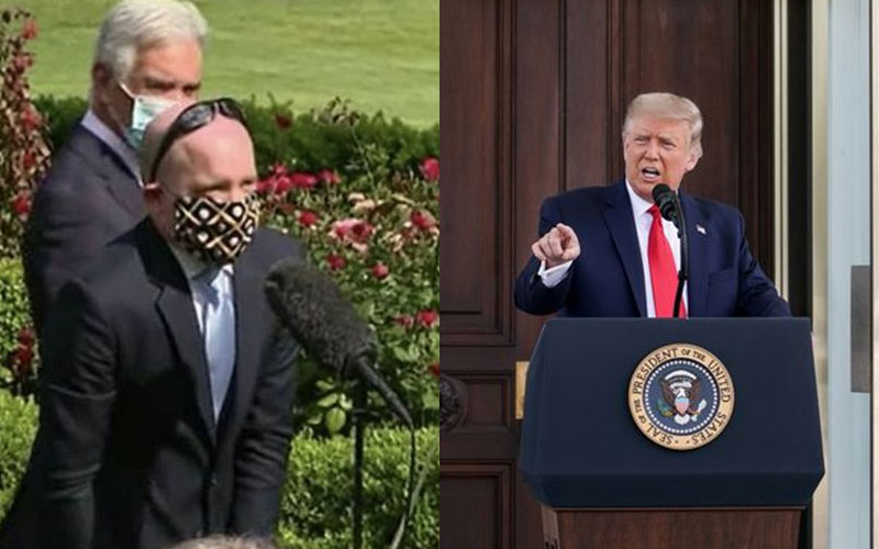 Trump orders journalist to remove face mask but he refuses in White House showdown