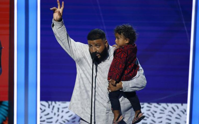 DJ Khaled holds his son Asahd Tuck Khaled after wi
