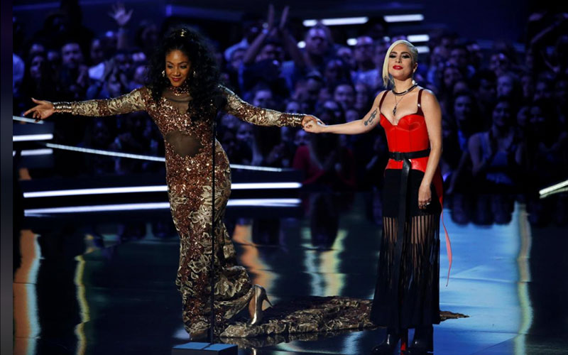 Singer Lady Gaga (R) and host Tiffany Haddish on S
