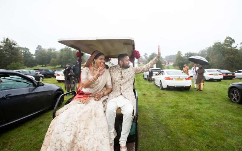 Couple marry in front of 250 guests in cars to get around limit of attendees