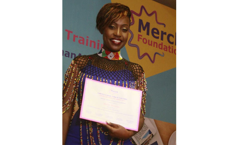 KTN Sharon Momanyi display her certificate after w