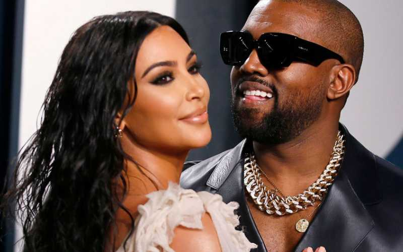 Kim Kardashian urges fans to vote while her hubby Kanye casts ballot for himself