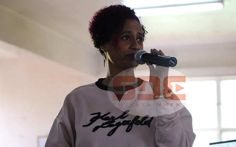 Habida speaking to students of Kenya High School