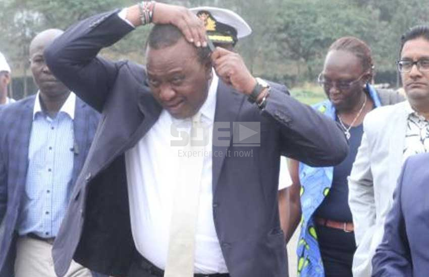 PHOTOS:  How President Uhuru achieves his signature hairstyle