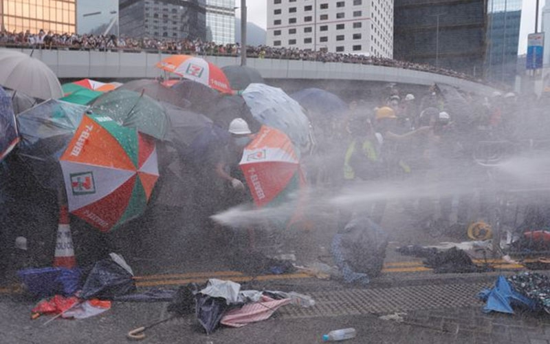 Hong Kong protest: Hundreds storm parliament building as police fire tear gas