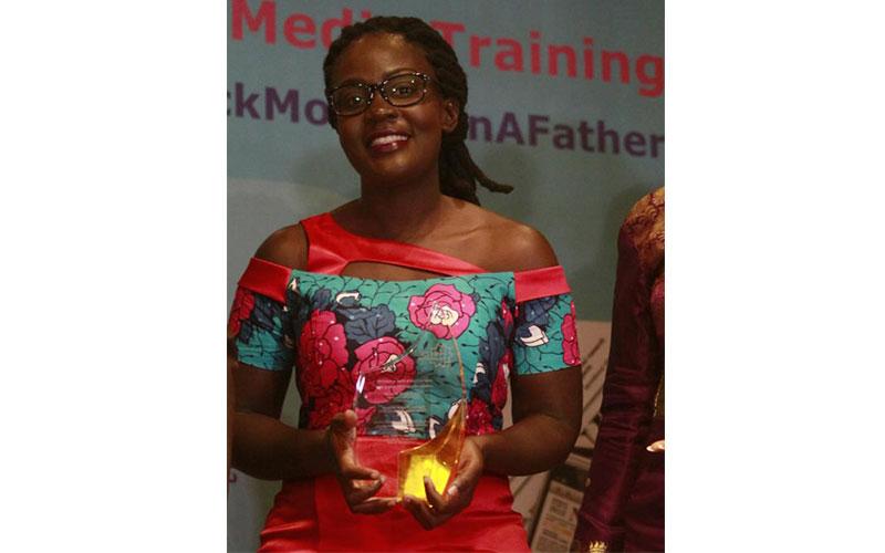 NTV Kenya Namukabo Werunga display trophy and cert