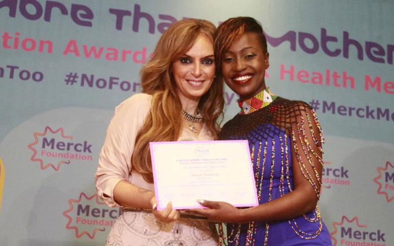 KTN Sharon Momanyi receive certificate from Merck